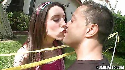 Janie gets tied up oudoors in back yard
