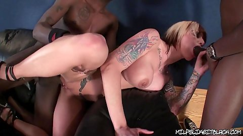 Milf gets fucked while sucking another black cock