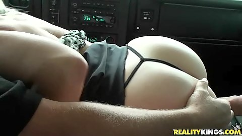 Milf sucks off a cock in the drivers seat