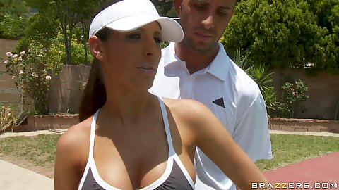 Hot babe with big tits practicing some tennis moves