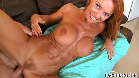 Milf Janet Mason spreads legs and jerks penis