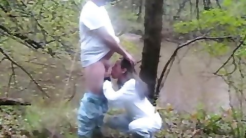 Couple out in the woods by a lake getting naughty