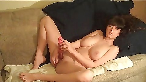 Hg spreading legs and inserting dildo into own pussy