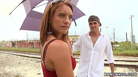 Hot milf Olivia Sinclair walking around rail tracks