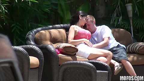 Couple in their own private backyard on sofa