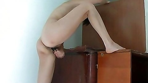 What a slut is trying to fuck herself every way possible