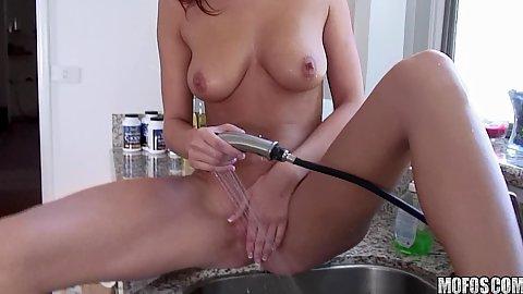 Hot redhad babe washing her pussy in kitchen sink