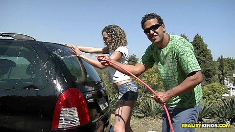 Hot latina washing a car outdoors