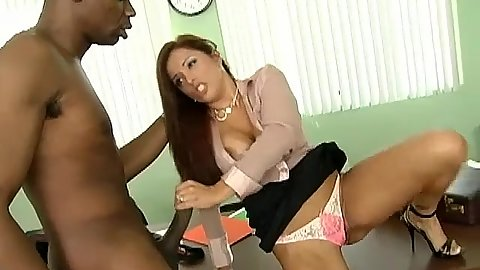 Busty brunette sucks on a huge black cock