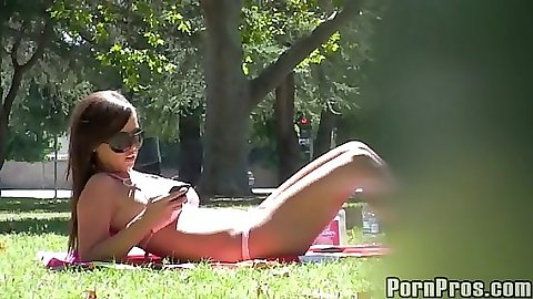 Hut babe tanning in the park in a bikini violated
