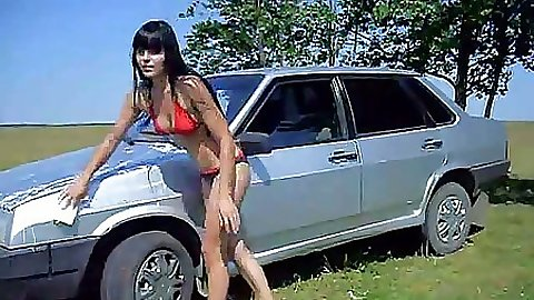 Babe washing a car in the field