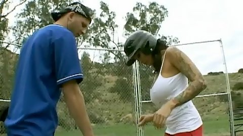 Busty chick practices her baseball swing