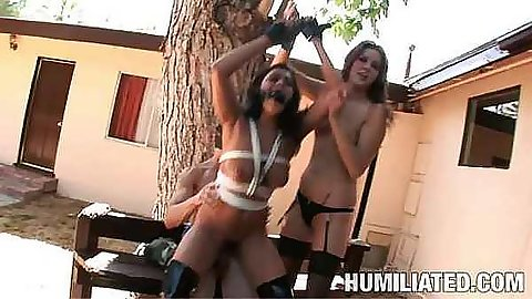 Tied up with ropes busty sluts fucked outdoors