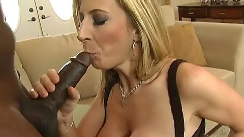 Milf sucks on big black cock