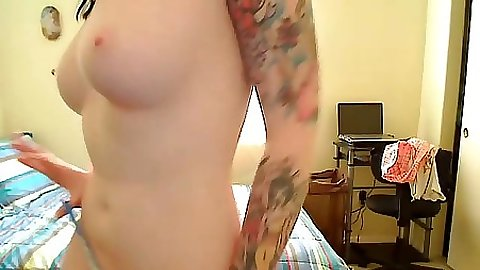 Cute gf with tattoo and smooth pussy touches herself