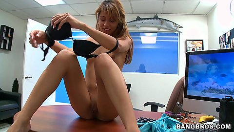 Naked hottie on the table touching herself solo