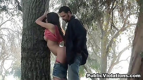 Doggy style fucking near a tree in a public park voyeur