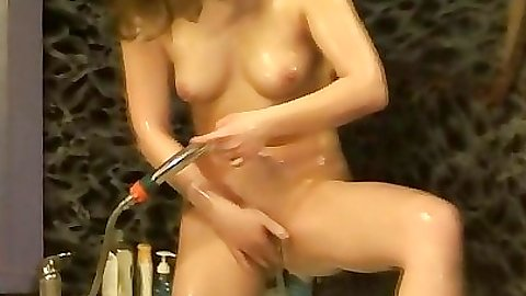 Chick takes a shower an washes her pussy