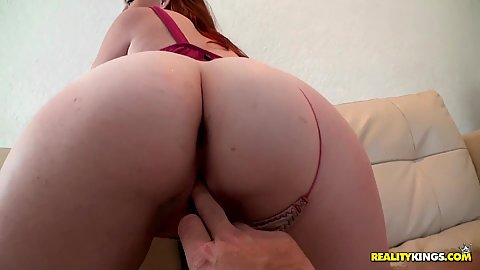 Hot redhead babe Ivey shows off her ass