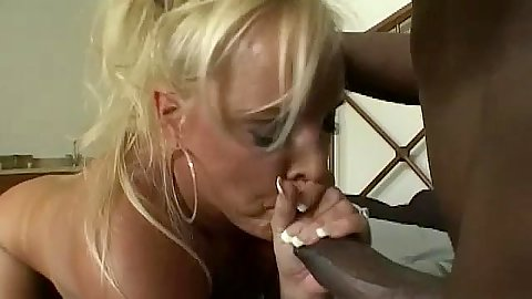 Blonde milf sucks hue black cock and then anal rides it
