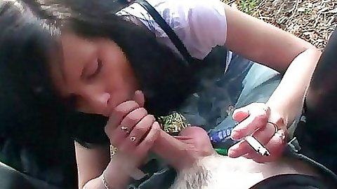 Smoking babe sucks dick at the same time