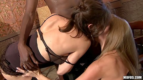 Hot milfs team up on a huge black cock in 3some