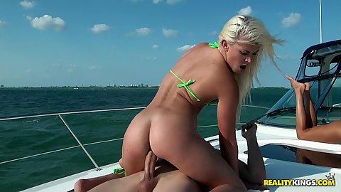 Cowgirl fucking sexy babe in a bikini on a boat
