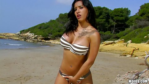 Dolce of Espana in a sexy bikini on the beach