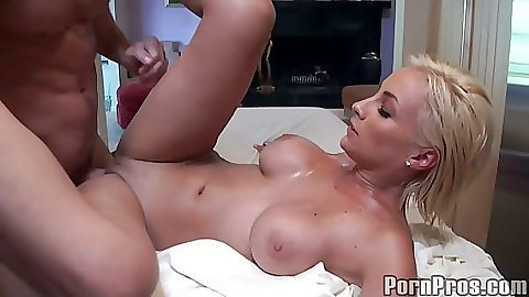 Lexi Swallow hangs off massage table durin gsex
