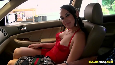 Sexy latina with no bra in the car