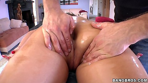 Phoenix Marie gets oiled up and ass fingered