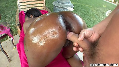 Black hottie spreads oiled up with lotion ass