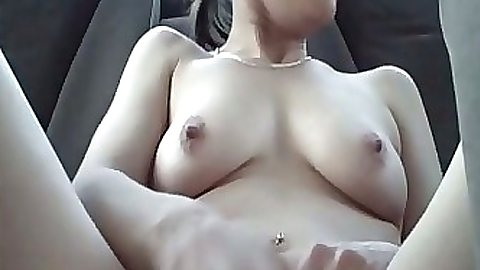 Naked amateur driving around in her car