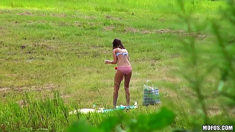 Teen alone outdoors tanning