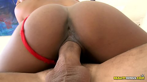 Pulled aside underwear on round ass sits on cock