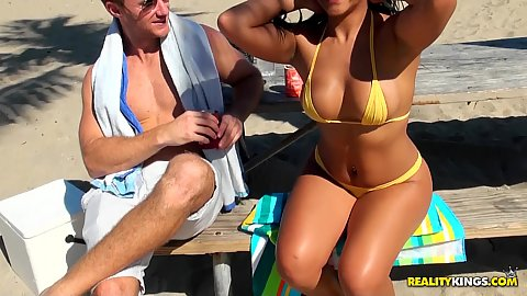 Out doors with hot busty brunette milf on the beach