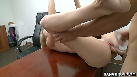 Karmen Blaze moans while she is filled full of cock on the table