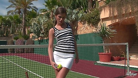 Teen babe Caprice looking cute in solo shot on tennis court