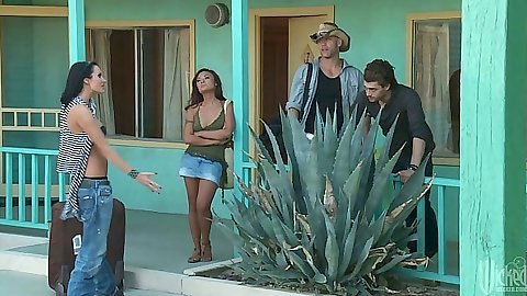 Outdoors with India Summer by the motel room wearing a tight skirt