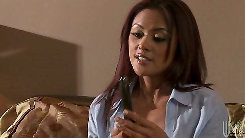 Asian Kaylani Lei wearing a shirt and self dildo fucking on bed