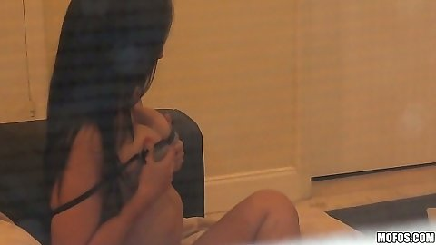 Spying on a cute latina Valerie Kay while she touches herself