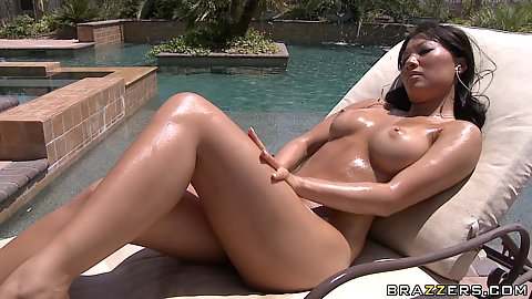 Hot asian with boobs tanning in the sun