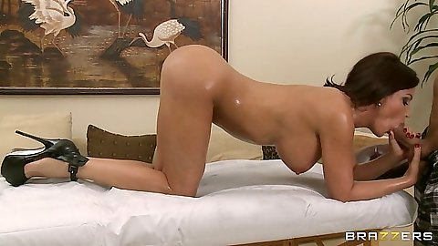 Busty milf Diamond Foxxx blowjob while covered with oil during massage