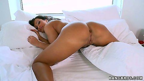 Big ass milf Lisa Ann laying on her stomach receiving ass play