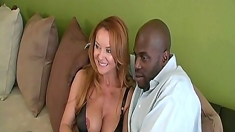 Janet Mason showing off her big milf tits