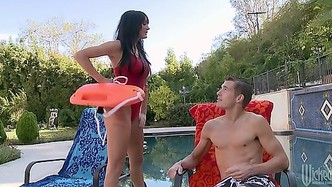 Lifeguard Alektra Blue at the pool checking cocks