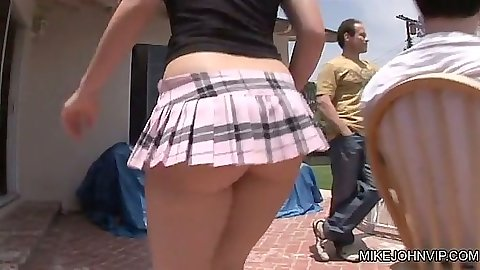 Super miniskirt on Katie St. Ives outdoors by the pool