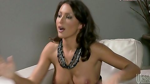 Big tits babe Lizz Tayler looking good sitting down topless