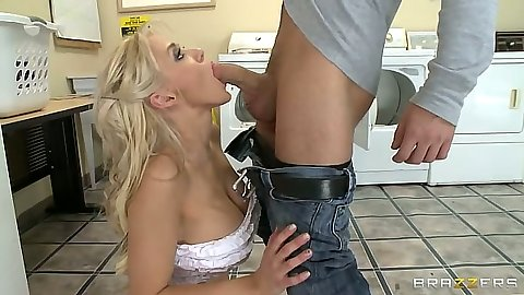 Tia McKenzie kneeling for a blowjob with big tits titty fuck