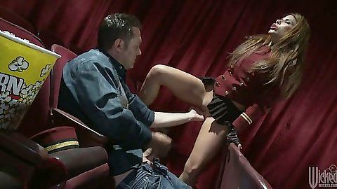 Reaching under Aleksa Nicole half dressed and in private theater